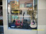 Guitars in Century Pawnbroker's Window on Cookman3-24-08